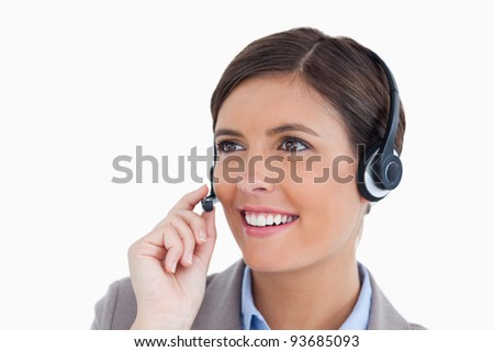 Close up of smiling female call center agent with headset against a white background