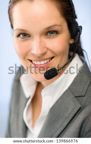 Close up of smiling female support phone operator with headset - stock photo