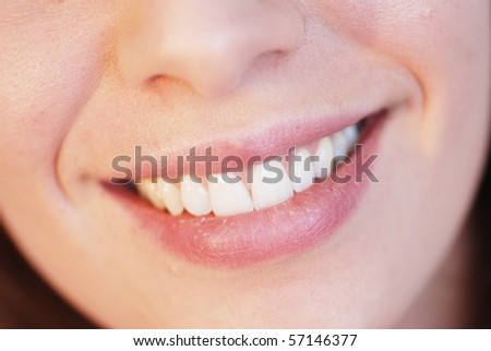 Close-up of smiling girl with beautiful teeth - stock photo