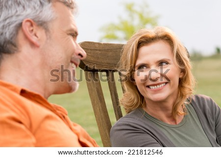 Close-up Of Smiling Mature Woman Looking Her Husband - stock photo