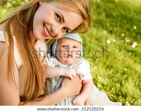 Close-up Of Smiling Mother With Her Adorable Baby - stock photo