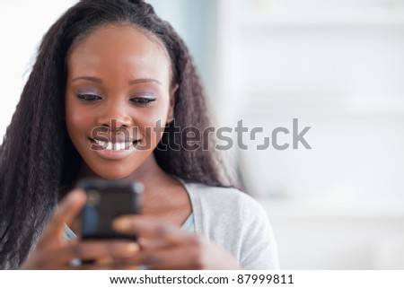Close up of smiling woman typing text