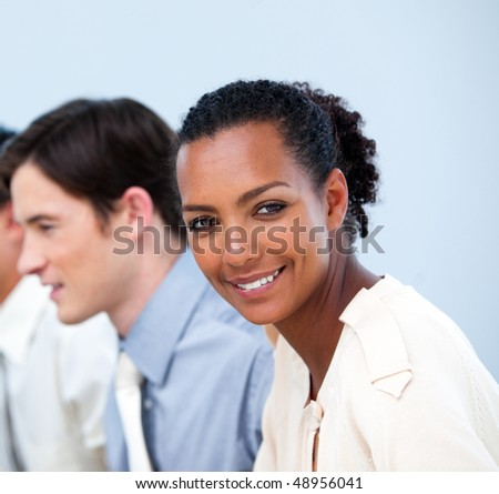 Close-up of smiling young business people at work - stock photo