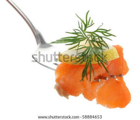 Close-up of smoked salmon snack on a fork - stock photo