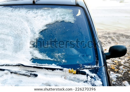 Close-up of snow-covered car windscreen  - stock photo
