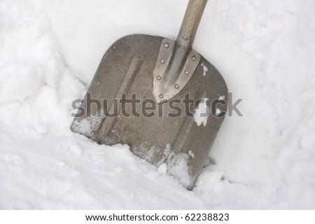 Close up of snow shovel - stock photo