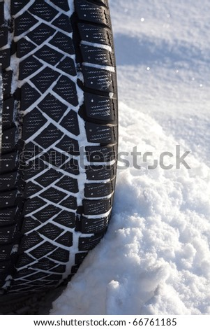 close up of snow tire in the winter time. - stock photo