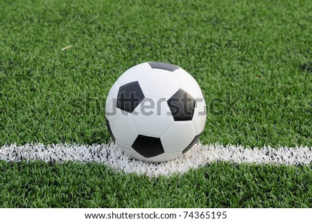 Close up of soccer ball on the center of soccer field