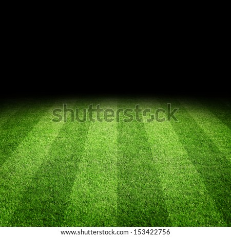 Close up of soccer or football field at night with copy space - stock photo