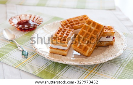 close up of soft waffles on a plate - stock photo