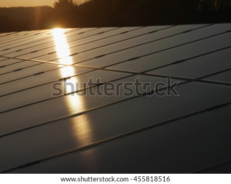 Close-up of solar panels in sunlight - stock photo