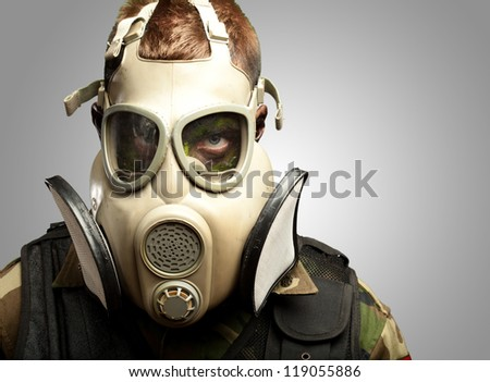Close-up Of Soldier Wearing Mask against a grey background