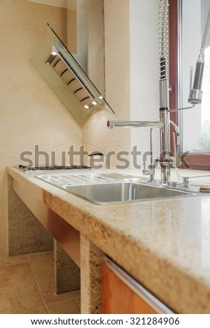 Close up of solid kitchen sink and worktop - stock photo