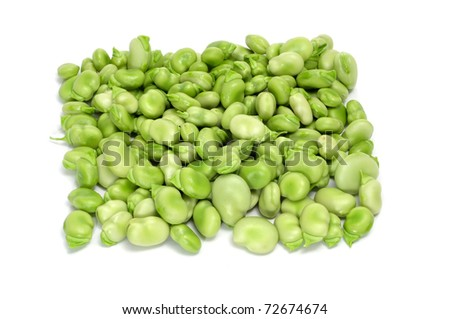 close up of some broad beans on a white background - stock photo