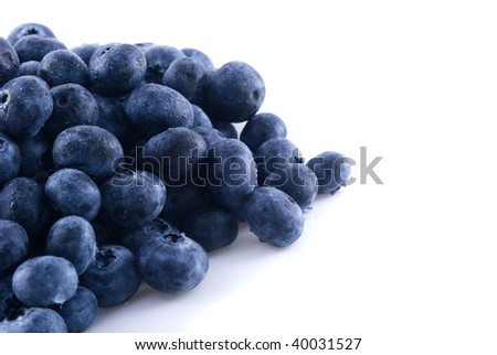 Close up of some fresh blueberries in a pile - stock photo