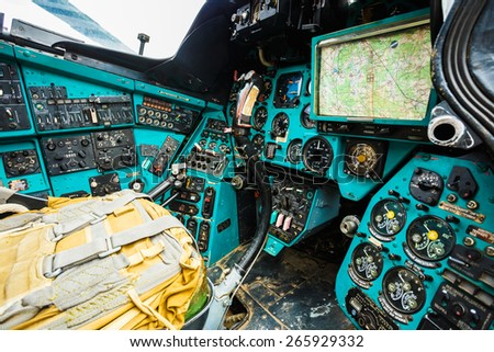 Close-up of some instruments in a helicopter cockpit in Mi-24. The Mil Mi-24 is a large helicopter gunship and attack helicopter and low-capacity troop transport with room for eight passengers. - stock photo