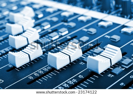 Close-up of sound mixer console faders. Macro background 01 - stock photo