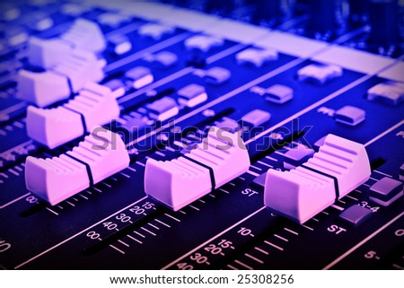 Close-up of sound mixer console faders. Macro background 05