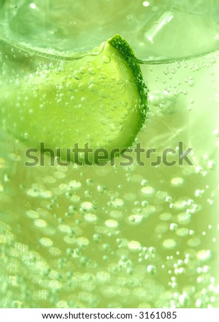Close-up of sparkling lime / lemon drink with ice. - stock photo