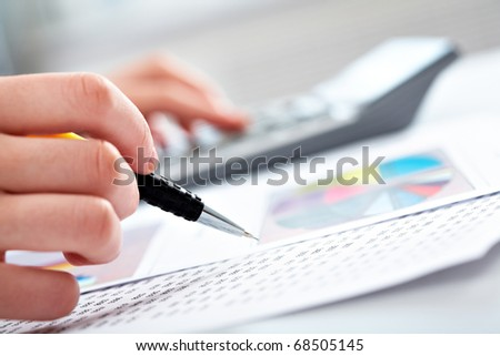 Close-up of specialist checking a financial analyze - stock photo