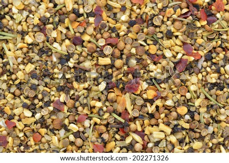 Close-up of spice marinade used to cook meat on BBQ - stock photo