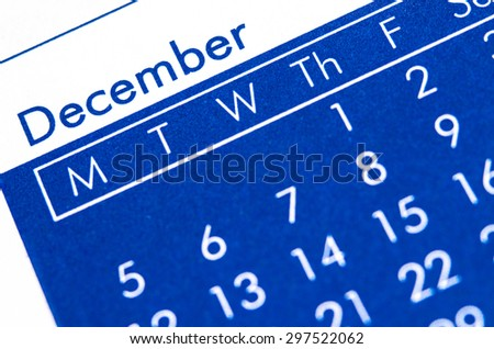 Close up of spiral bound calendar displaying month of December. - stock photo