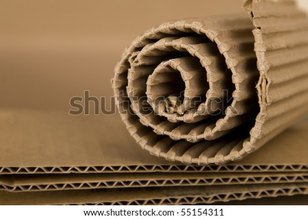 close-up of spiral made from brown cardboard - stock photo