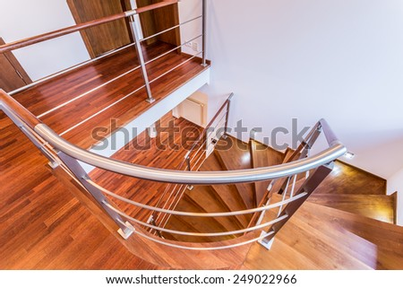 Close-up of spiral wooden stairs in luxury apartment - stock photo