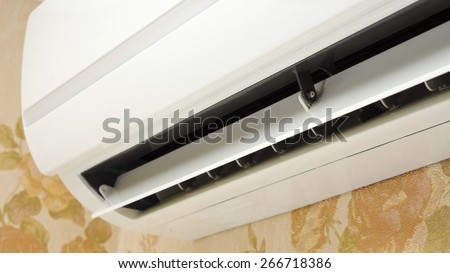 Close up of split system air conditioner in home interior - stock photo