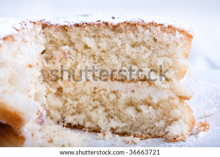 close up of sponge cake from low viewpoint with shallow depth of focus