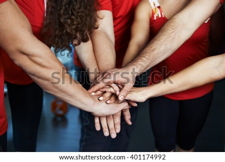 Close-up of sport team stacking hands. Concept of fitness community, partnership and cooperation.  - stock photo