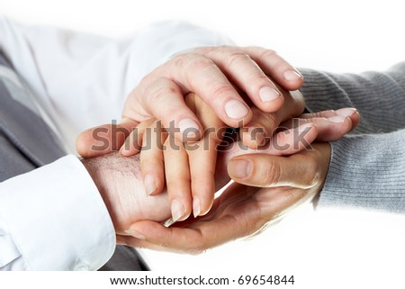 Close-up of spouses? clutched hands - stock photo