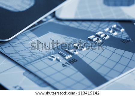 Close up of stack of credit cards toned blue - stock photo