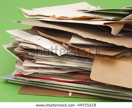 Close-up of stack of paper and cardboard for recycling. Selective focus - stock photo