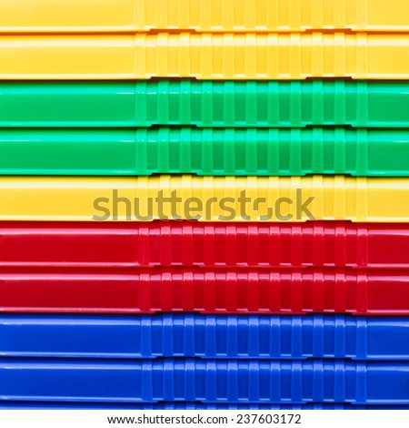 Close up of stacked plastic crates as a background