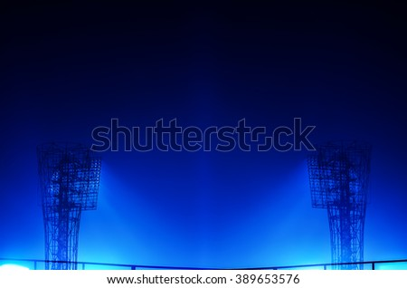 Close-up of stadium floodlights against a dark night sky background - stock photo