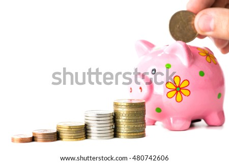 close-up of stairs from coins, piggy bank and coin in hand on background