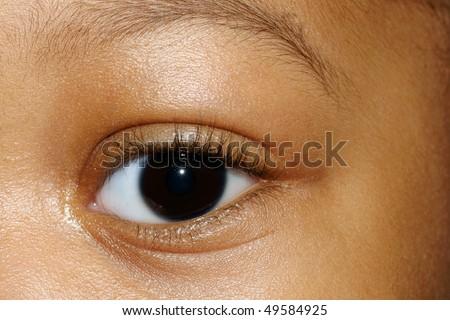 close up of staring eye of toddler boy - stock photo