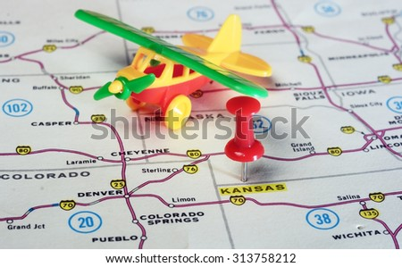 Close up of state Kansan USA map with red pin and airplane  - Travel concept - stock photo