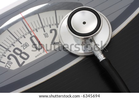 Close up of stethoscope on a weight scales - stock photo
