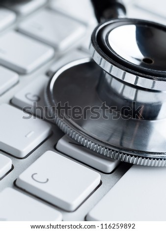 Close up of stethoscope on computer keyboard. Medicine concept - stock photo