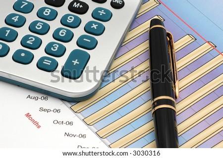 Close-up of Stock Market Volume Bar Chart, Calculator and Pen - stock photo