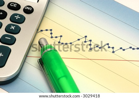 Close-up of Stock Report with Calculator and Green Pen - stock photo