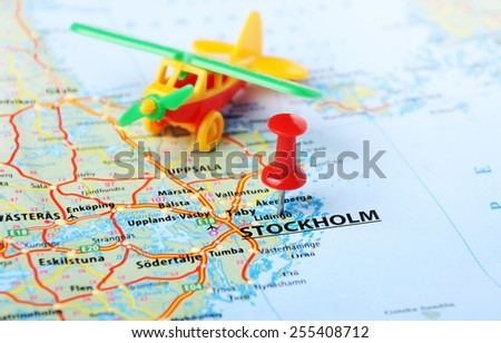 Close up of Stockholm ,Sweden map with red pin and airplane toy - Travel concept - stock photo