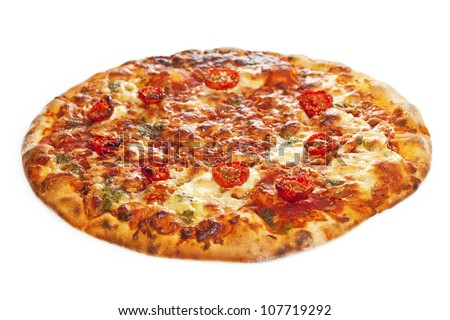 Close-up of stone backed pizza margarita with sun dried tomatoes and pesto.  isolated on white background - stock photo