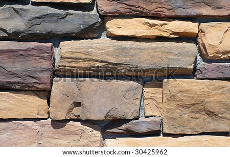 Close up of stone wall - stock photo