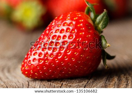 Close-up of strawberry on wooden table. - stock photo