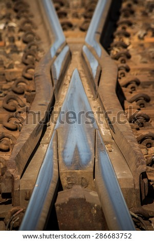 Close-up of structure on cross over rail switch - stock photo