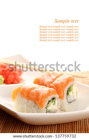 Close-up of sushi on a plate, soy sauce. - stock photo