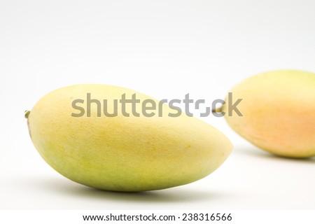Close up of sweet and delicious ripe mango fruit for light appetiz er on white background - stock photo